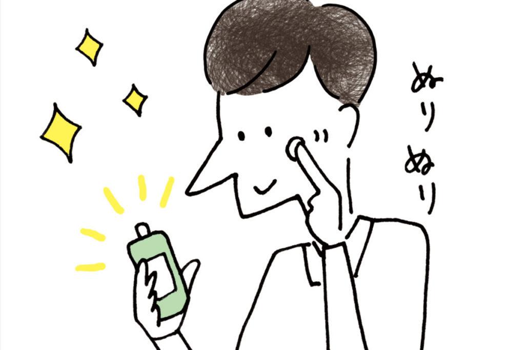 ニキビに薬を塗る男性