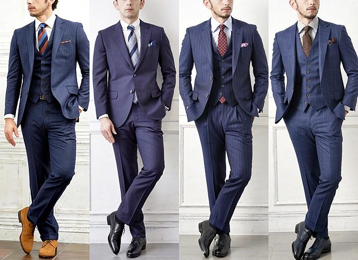 青いスーツの男性